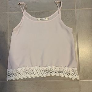 light pink tank top , with lace at the bottom